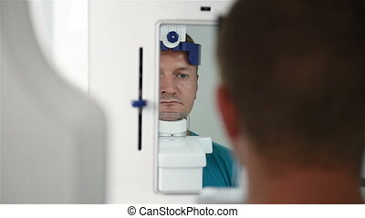 man undergoing tests - Patient Being Prepared For dental...