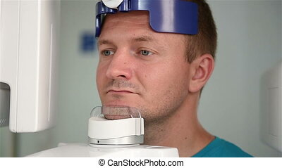 man undergoing tests on dental X-Ray panoramic scanner