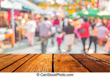 Blurred image of people walking at day market in sunny day,...