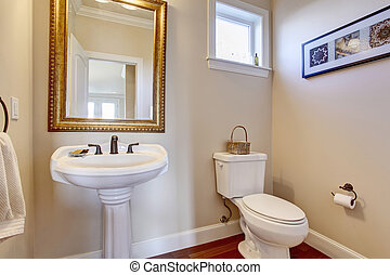 Simple bathroom with white walls.