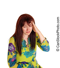 Crying woman with bad headache - A middle age woman in a...