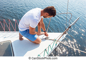 Positive man adjusting his yacht - Almost ready to sail Nice...