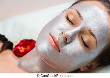 Cosmetology spa facial. Beautiful brunette in a spa salon....
