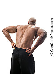 Low Back Pain - Portrait of a muscle fitness man reaching...