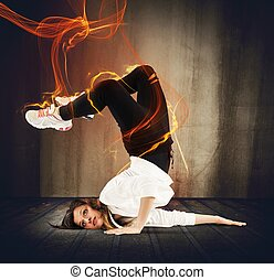 Fire breakdancer - Agile breakdancer girl surrounded by fire...