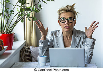 Shocked business woman with laptop