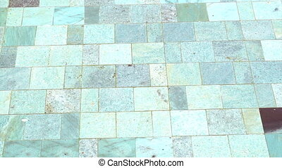pool water and natural stone tile - detail of clear swimming...
