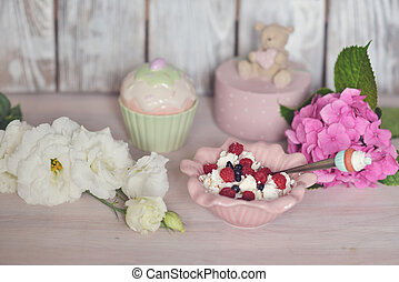sweet dessert of berries - on a wooden board flower...