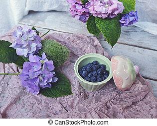 sweet dessert of berries - on a wooden board flower...