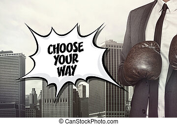 Choose your way text with businessman wearing boxing gloves...