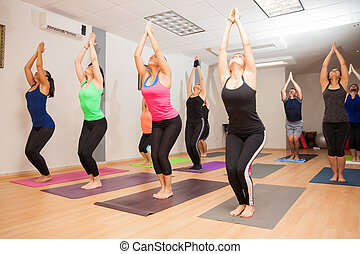 Real yoga class in progress - Wide angle view of a big group...