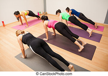Working out in a yoga studio - Wide angle view of a group of...