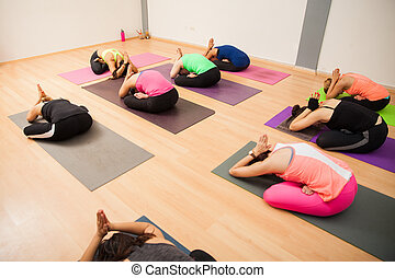 Wide angle view of a yoga class - Wide view of a large group...