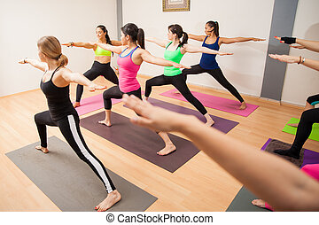 Warrior pose in a large group - Student point of view of a...
