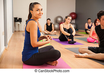 Latin girl in a yoga class - Portrait of a cute young Latin...