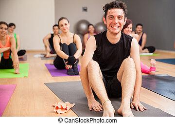 Young man enjoying yoga class - Portrait of a young Hispanic...