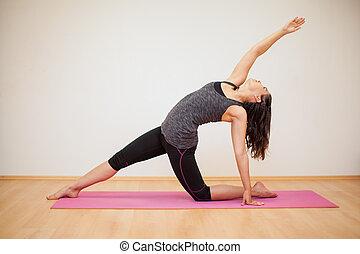 Cute Latin girl doing some yoga