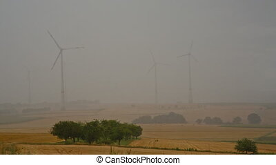 strong rain and windmills - thunderstorm with heavy rain and...