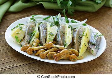 appetizer of herring, boiled potato