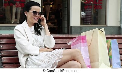 On Cell Phone About Shopping - Beautiful lady resting after...