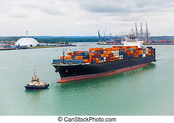 freighter shipping - transporter ship sailing from dock in...