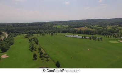 golf course and landscape filmed from the top - a drone...