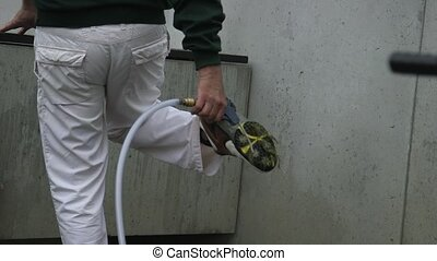 man cleaning his shoes after playing golf - man dressed with...
