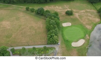 golf club and the area around filmed by a drone - a drone is...