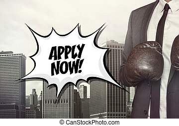 Apply now text with businessman wearing boxing gloves on...