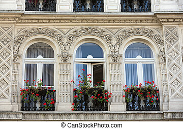Facade of  house with balcony in Montmartre. Paris, France