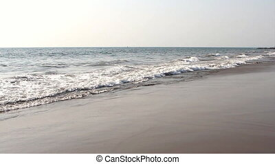 waves touching sandy beach - ocean waves touching sandy...