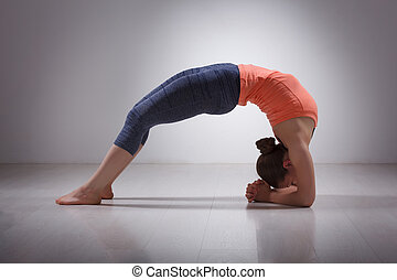 Beautiful sporty fit yogi girl practices yoga asana viparita...