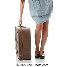 Caucasian woman legs with travel case isolated on white...