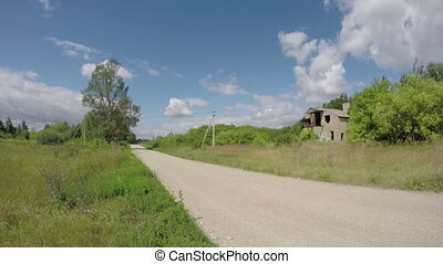 rural gravel road  derelict house