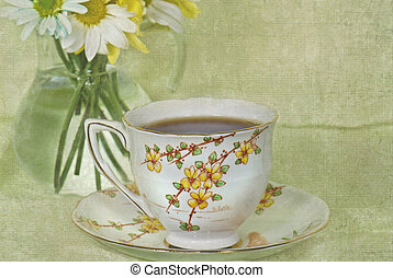 English Tea Time - Vintage tea cup with daisy bouquet in...