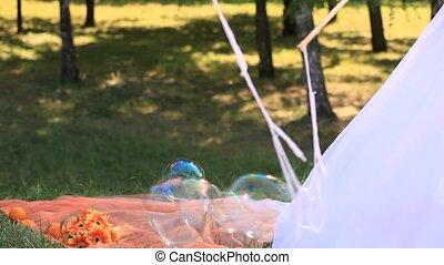 Soap Bubbles - Bride making huge soap bubbles