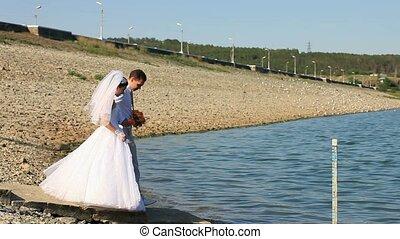Wedding On A Lake - Bride and groom on a lake