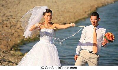 Wedding Bubbles - Wedding couple making soap bubbles