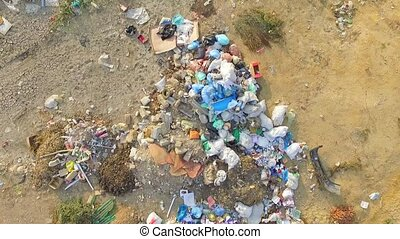 AERIAL VIEW Garbage dumps - AERIAL VIEW The camera flies...
