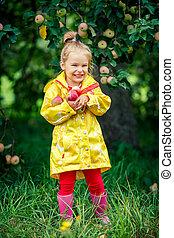 Little girl in the apple garden - Smiling little girl...