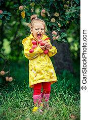 Little girl in the apple garden - Laughing little girl...
