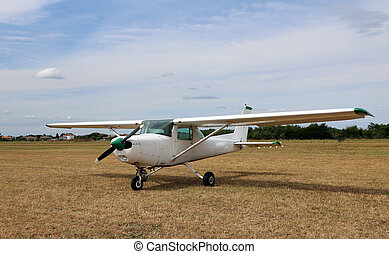 light aircraft at the airport with a propeller - White...