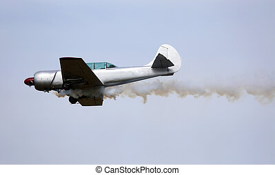 Plane with dark smoke from the engine - historic warplane...