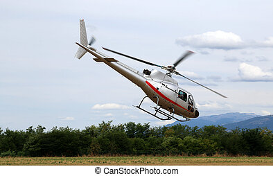 helicopter takes off from the airport to bring tourists over...