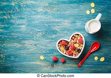 Delicious granola with berries Food background with...