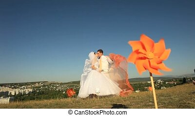 On A Hill - Wedding couple on a hill among whizzers