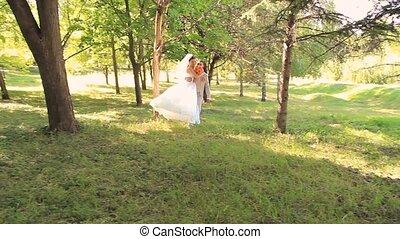 Wedding Romance - Groom carrying bride in his hands