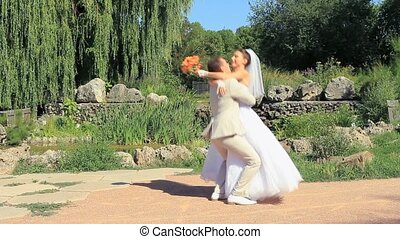 On The Wedding Day - Bride and groom in a park on the...