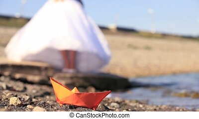 Paper Boat - Origami paper boat and a bride Close-up