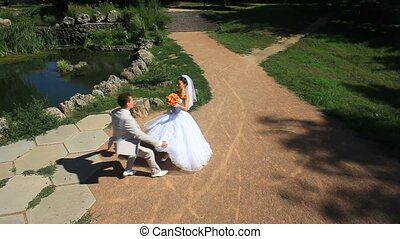 Wedding On A Sunny Day - Wedding couple in a park after the...